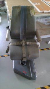 Airplane passenger seat in need of repair